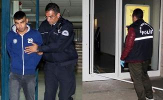 Cezaevine girmek için bankayı taşlayıp cam kapıyı kırdı