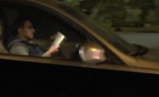 Bursa'da trafikte kitap okuyan sürücüye kötü haber!