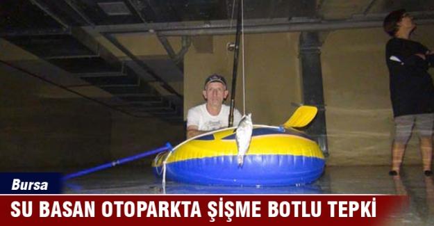 TOKİ'nin su basan otoparkına şişme botlu tepki!