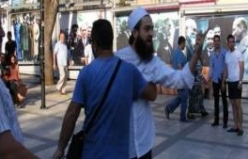 Sokak müzisyenlerine pitbull ile saldırı