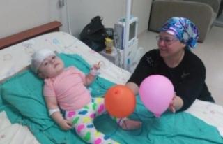 11 aylık bebek faciadan kurtuldu