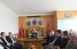 AK PARTİ'DEN MHP'YE HAYIRLI OLSUN ZİYARET