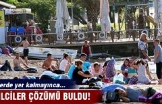 Otellerde yer kalmadı, tatilciler plajlarda kalıyor
