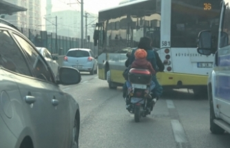 Bursa'da motosiklet üzerinde tehlikeli yolculuk kameralara yansıdı