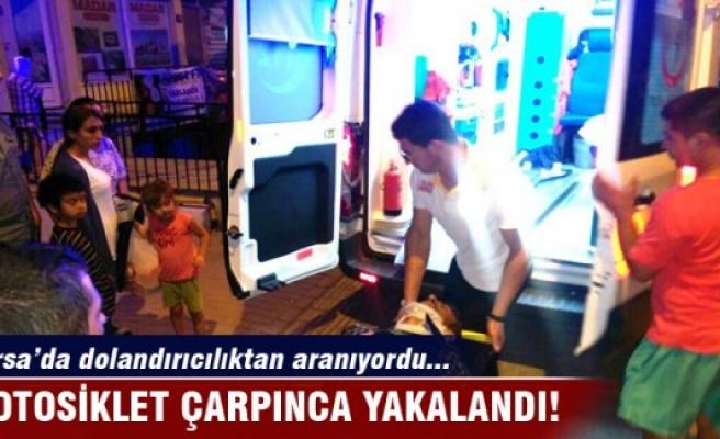 Bursa'da dolandırıcılıktan aranan kişi motosiklet çarpınca yakalandı